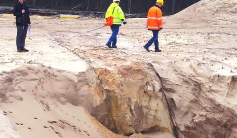 Störungsortung in einer Sandgrube, um Hangrutschungen und Uferabbrüche vorhersagen zu können